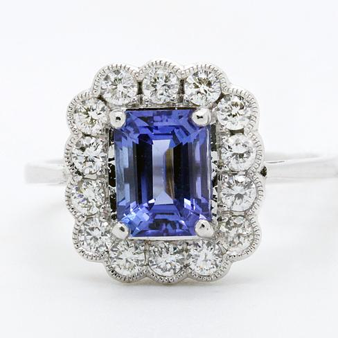 Classic Tanzanite Surrounded By Diamonds Ring - Item # R6180 - Reliable Gold Ltd.